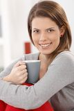 Cheerful woman with coffee cup Stock Photo