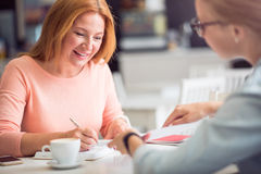 Cheerful woman conducting an interview Stock Photography