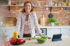 Cheerful woman cooking on modern kitchen Stock Photography