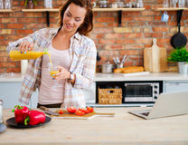 Cheerful woman cooking on modern kitchen Royalty Free Stock Photography