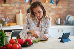 Cheerful woman cooking on modern kitchen Stock Photo