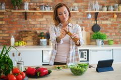 Cheerful woman cooking on modern kitchen Royalty Free Stock Images