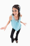 Cheerful woman dancing while listening to music Royalty Free Stock Photo