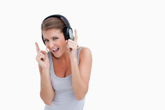 Cheerful woman dancing while listening to music Royalty Free Stock Photos