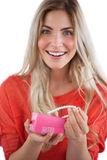 Cheerful woman discovering necklace in a gift box Royalty Free Stock Photo