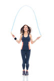 Cheerful woman doing exercises with jumping rope Stock Photos
