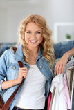 Cheerful woman doing shopping Royalty Free Stock Photos