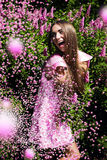 Cheerful woman in dress with pink confetti Royalty Free Stock Photo