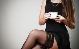 Cheerful woman drinking coffee Royalty Free Stock Photos