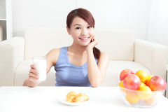 Cheerful woman drinking milk. Sitting on her sofa at home, asian beauty Stock Photos