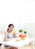 Cheerful woman drinking an orange juice Royalty Free Stock Images