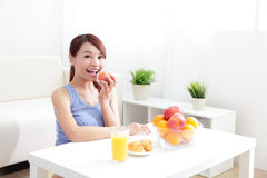 Cheerful woman eat breakfast Stock Image