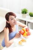 Cheerful woman eat breakfast Stock Photos