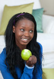 Cheerful woman eating an apple Royalty Free Stock Photo