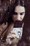 Cheerful woman eating chocolate Stock Image