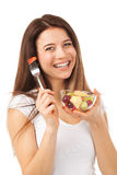 Cheerful woman eating fruits Royalty Free Stock Photography