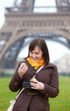 Cheerful woman eating macaroons Stock Photography