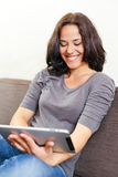 Cheerful woman and electronic tablet Stock Photo