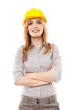 Cheerful woman engineer with arms folded Stock Photography