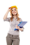 Cheerful woman engineer wearing protection helmet and holding a Royalty Free Stock Images