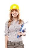 Cheerful woman engineer wearing protection helmet and holding a Stock Image