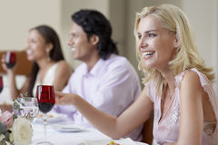 Cheerful Woman Enjoying Dinner Party With Friends Stock Photos