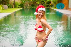 Woman enjoying winter vacation in exotic luxury destination. Cheerful woman enjoying winter vacation in exotic luxury destination stock images
