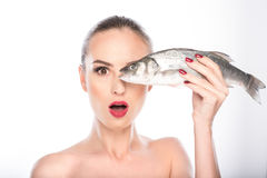 Cheerful woman is excited about seafood stock photo