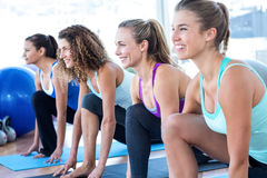 Cheerful woman in fitness studio doing lunge pose Stock Photo