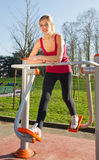Cheerful woman in fitness wear exercising with equip Royalty Free Stock Photos
