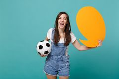 Cheerful woman football fan cheer up support team with soccer ball, empty blank yellow Say cloud, speech bubble isolated. On blue turquoise background. People stock images