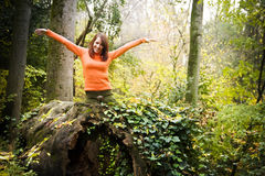 Cheerful woman in forest Stock Photography