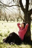 Cheerful woman in forest Royalty Free Stock Photos