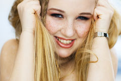 The cheerful woman with freckles laughs Stock Image