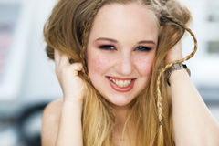 The cheerful woman with freckles laughs Stock Photo
