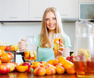 Cheerful woman with fruits beverage Stock Image