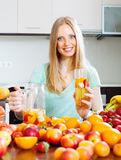 Cheerful woman with fruits beverage Stock Photography