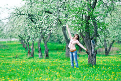 Cheerful woman in the garden Stock Photography