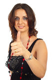 Cheerful woman gives thumbs Royalty Free Stock Images