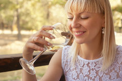 Cheerful woman with a glass of white wine Royalty Free Stock Photography