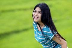 Cheerful woman on the green meadow Stock Photo