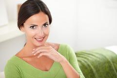 Cheerful woman in green shirt looking at camera Royalty Free Stock Photography