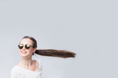 Cheerful woman with hair in the wind Stock Photo