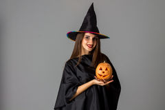 Cheerful woman in halloween style clothes Royalty Free Stock Photo