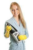 Cheerful woman with handheld vacuum cleaner Royalty Free Stock Images