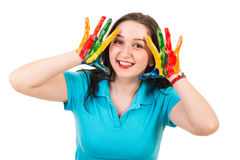 Cheerful woman with hands in paints Royalty Free Stock Image