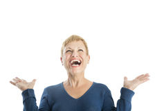 Cheerful Woman With Hands Raised Looking Up Royalty Free Stock Photography