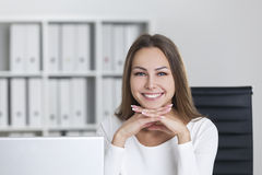 Cheerful woman with hands under chin Royalty Free Stock Image