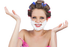 Cheerful woman with hands up and shaving foam on face Stock Image