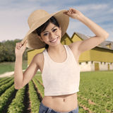 Cheerful woman with hat at farmland Stock Photos